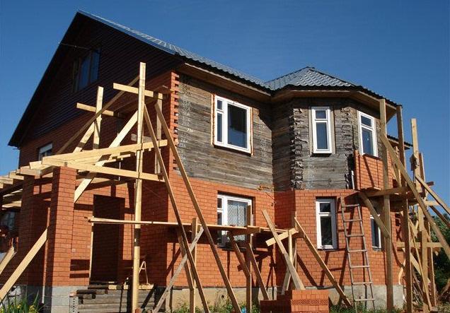 Отделка фасада дома кирпичем