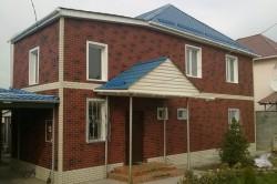 Небольшой дом отделанный сайдингом